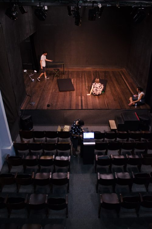 Actors preparing for a rehearsal of a play.